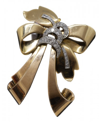 Broche noeud en or et diamands