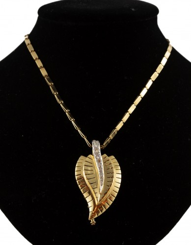 Van Cleef and Arpel -  Gold pendant set with diamonds