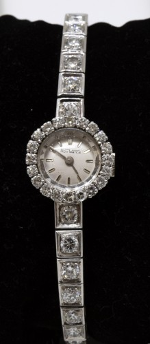 "20th century - Platinum watch brand "" Roy Watch"" set with TA diamonds"