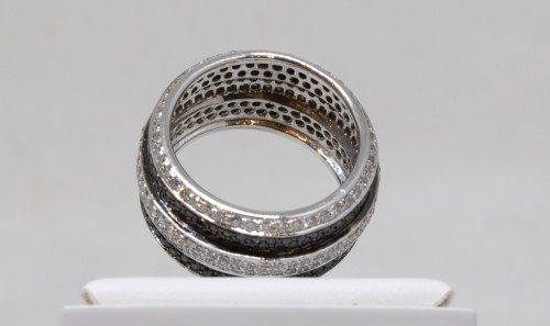 White gold ring set with small white and black diamonds -