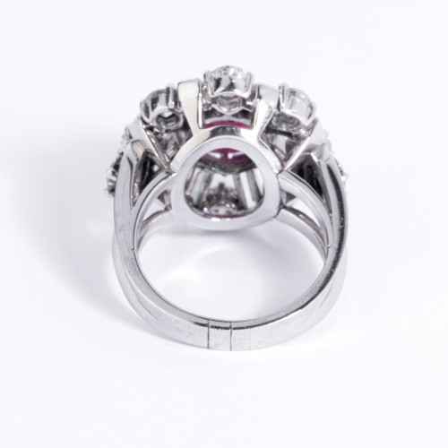 Platinum ring set in its center with a cabochon ruby and diamonds -