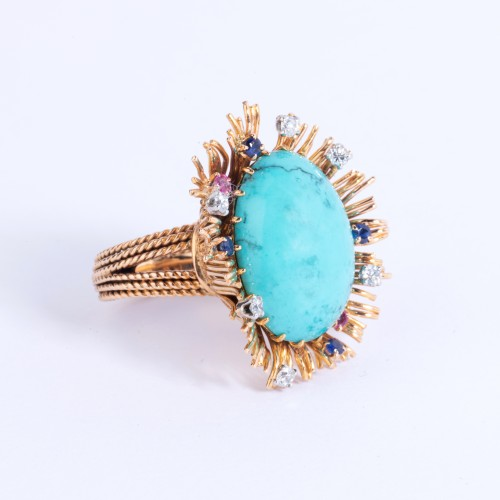 Gold ring set in its center with turquoise and small diamonds and sapph -
