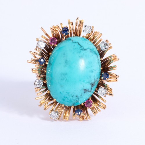 20th century - Gold ring set in its center with turquoise and small diamonds and sapph
