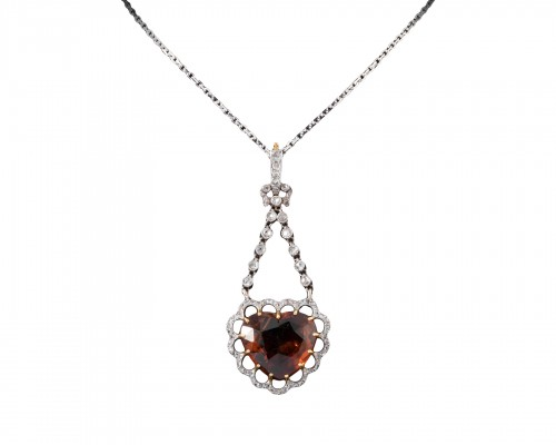 Gold pendant set with a citrine surrounded by small diamonds