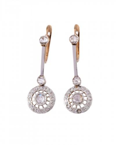 18k gold drop earrings set with a diamond