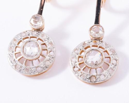 18k gold drop earrings set with a diamond -