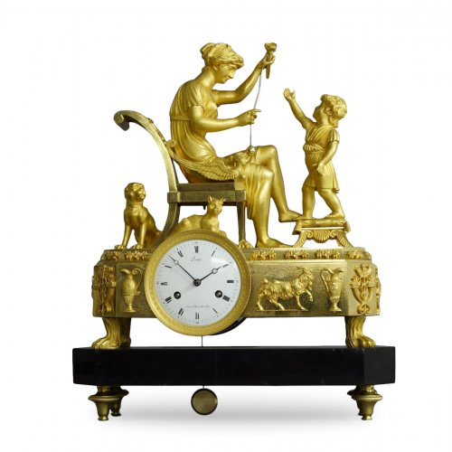 "French Empire-period mantel clock ""The Cup-and-Ball Lesson"""