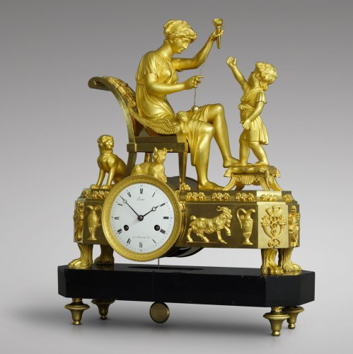 "French Empire-period mantel clock ""The Cup-and-Ball Lesson"" - Clocks Style Empire"