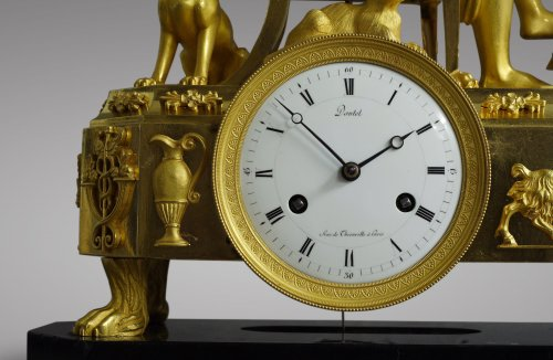 "French Empire-period mantel clock ""The Cup-and-Ball Lesson"" -"