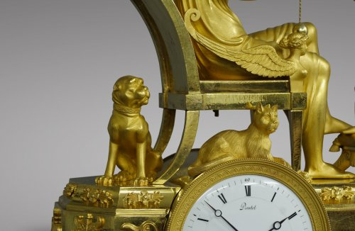 "19th century - French Empire-period mantel clock ""The Cup-and-Ball Lesson"""