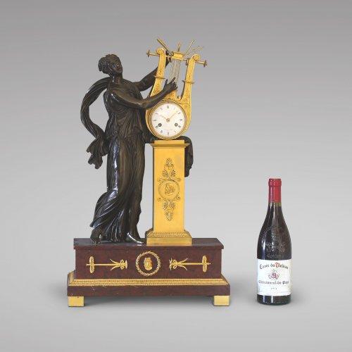 "Antiquités - ""ERATO"", Empire-period Mantle Clock, after Thomire"