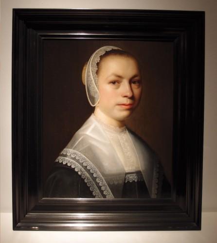 Portrait of a woman with a lace white cap - Dutch school 17th century -