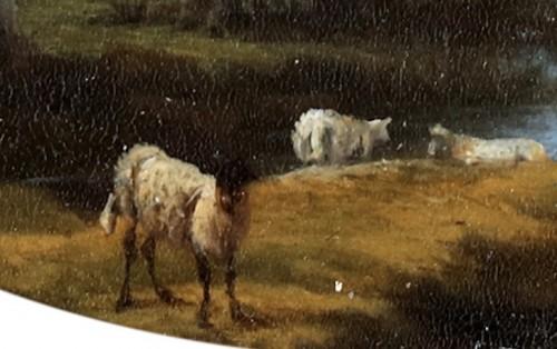 Willem de Heusch (1625 - 1692) -  Shepherd taking a rest near the water, while his flock is grazing. -
