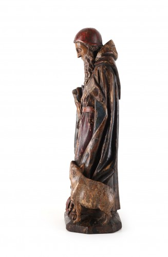 A group representing Saint Anthony with his pig standing in flames -