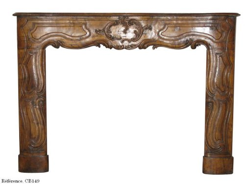 Antique Louis XV style fireplace in walnut