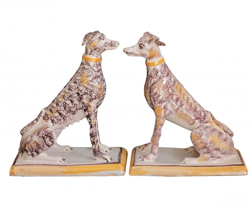 Pair of seated greyhounds in Brussels faience