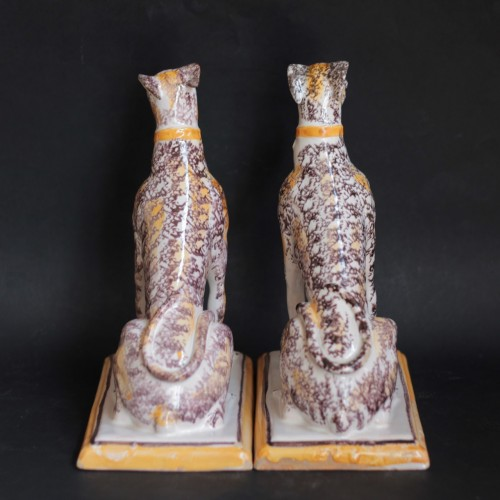 Porcelain & Faience  - Pair of seated greyhounds in Brussels faience