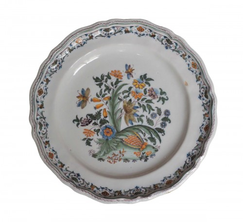Moustiers plate with pomegranate decoration, 18th century.