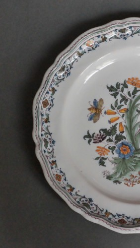 Porcelain & Faience  - Moustiers plate with pomegranate decoration, 18th century.