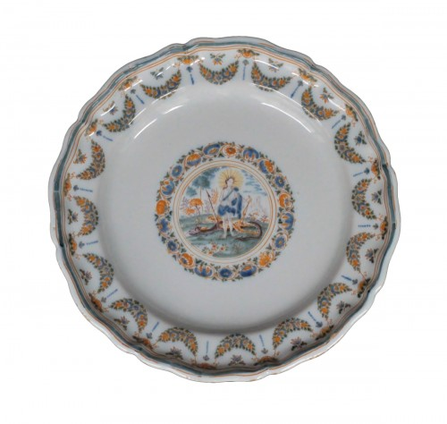 Moustiers faience plate with Apollon and the snake Python, 18th century.