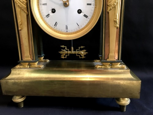 Antiquités - Bronze Directoire clock - The Blacksmith