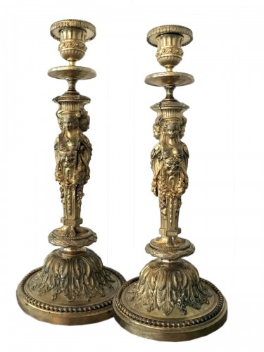 Pair of Louis XVI style bronze candlesticks