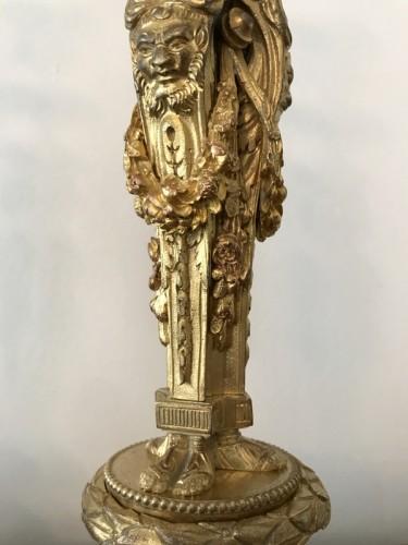 Pair of Louis XVI style bronze candlesticks -