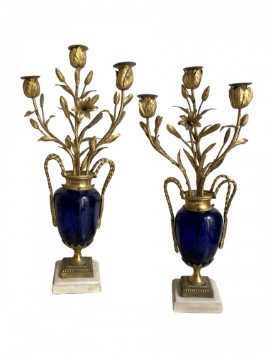 Pair of Louis XVI candlesticks in blue glass and gilt bronze