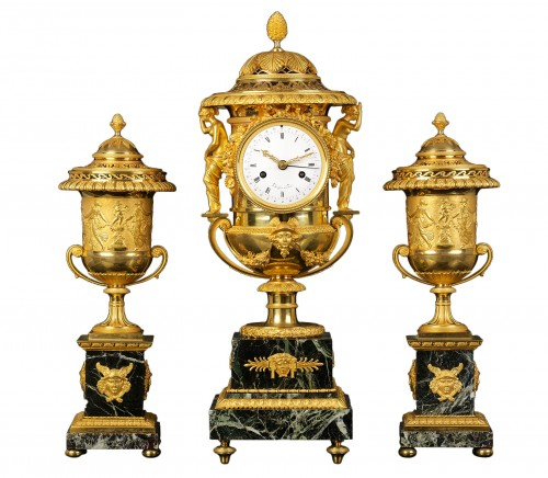 An Empire Suite of an Urn-shaped Mantel Clock and Two Vases