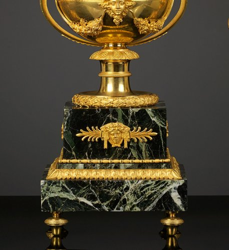 19th century - An Empire Suite of an Urn-shaped Mantel Clock and Two Vases