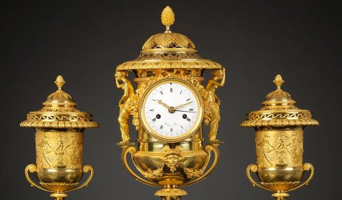 An Empire Suite of an Urn-shaped Mantel Clock and Two Vases   - Empire
