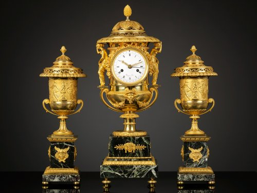 Empire - An Empire Suite of an Urn-shaped Mantel Clock and Two Vases
