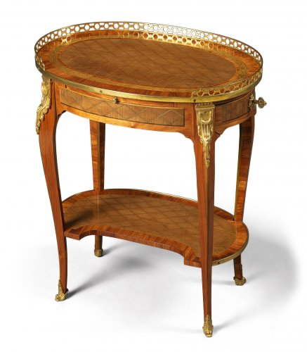 A French Transitional Small Oval Writing Table