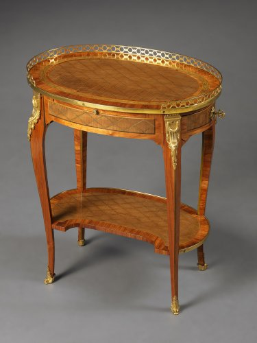 Furniture  - A French Transitional Small Oval Writing Table