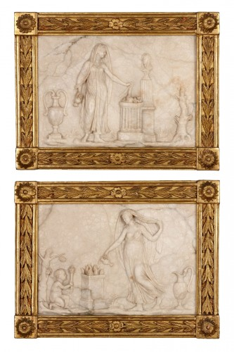 Pair of Austrian alabaster plaques in giltwood frames