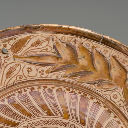 Porcelain & Faience  - A lusterware plate. Manises Circa 1550
