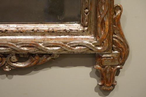 18th century Mirror in carved wood and silver plated wood -