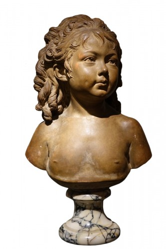 a terracota bust representing a young girl,at the age of 4 years old