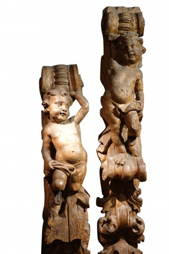 Pair of large carved fruitwood elements, France 17th century -