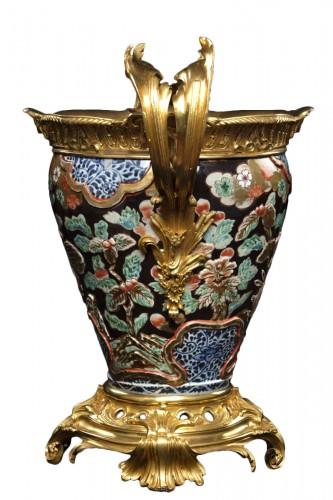 L'arte vase in porcelain and bronze