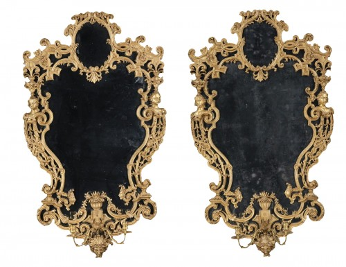Pair of carved and gilded wooden mirrors