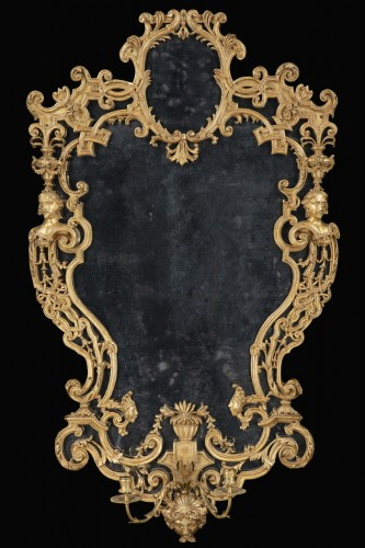 Pair of carved and gilded wooden mirrors  -