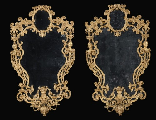 - Pair of carved and gilded wooden mirrors