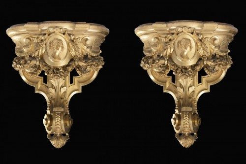 - Pair of carved and gilded wooden shelves
