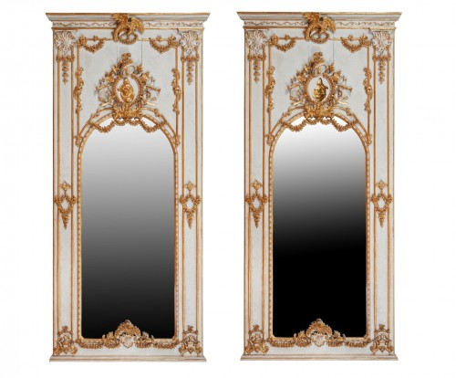 Pair of carved, laquered and gilded wooden mirrors