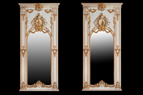 Pair of carved, laquered and gilded wooden mirrors  -
