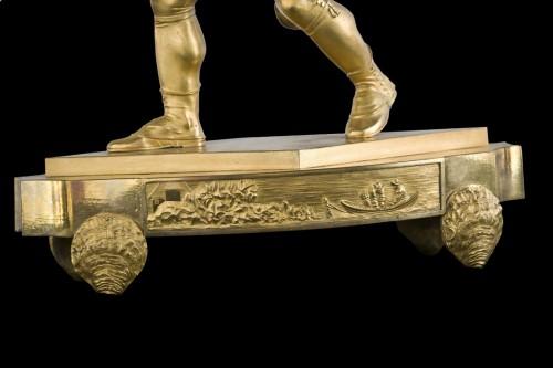 Horology  - Oyster seller - Empire clock in gilt bronze