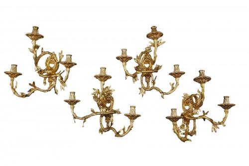4 appliques in gilded bronze