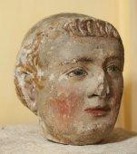 Xiv th c. limestone head of a monk with polychromy