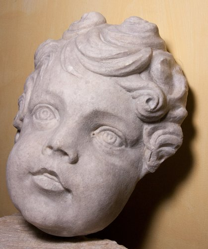 Sculpture  - Marble head of a putto, circa 1700